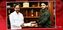 nithin-handovers-10lakh-cheque-to-cm-kcr