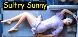 sunny-leone-s-sultry-pose-on-sofa