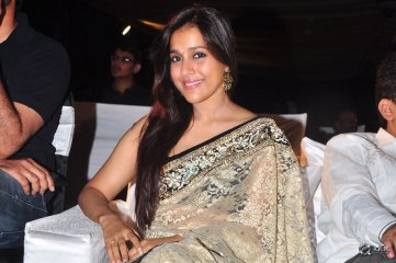 Rashmi Gautam at Dhanalakshmi Thalupu Thadithe Movie Audio Launch